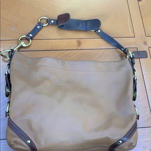 Brown leather females coach handbag